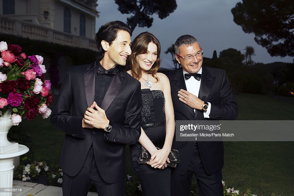 at the 21th Gala of AmFar Cinema Aganist AIDS, Adrien Brody, Carla Bruni Sarkozy and Jean-Christophe Babin are photographed for Paris Match in Cap d'Antibes at the Hotel Cap-Eden-Roc on May 22, 2014;