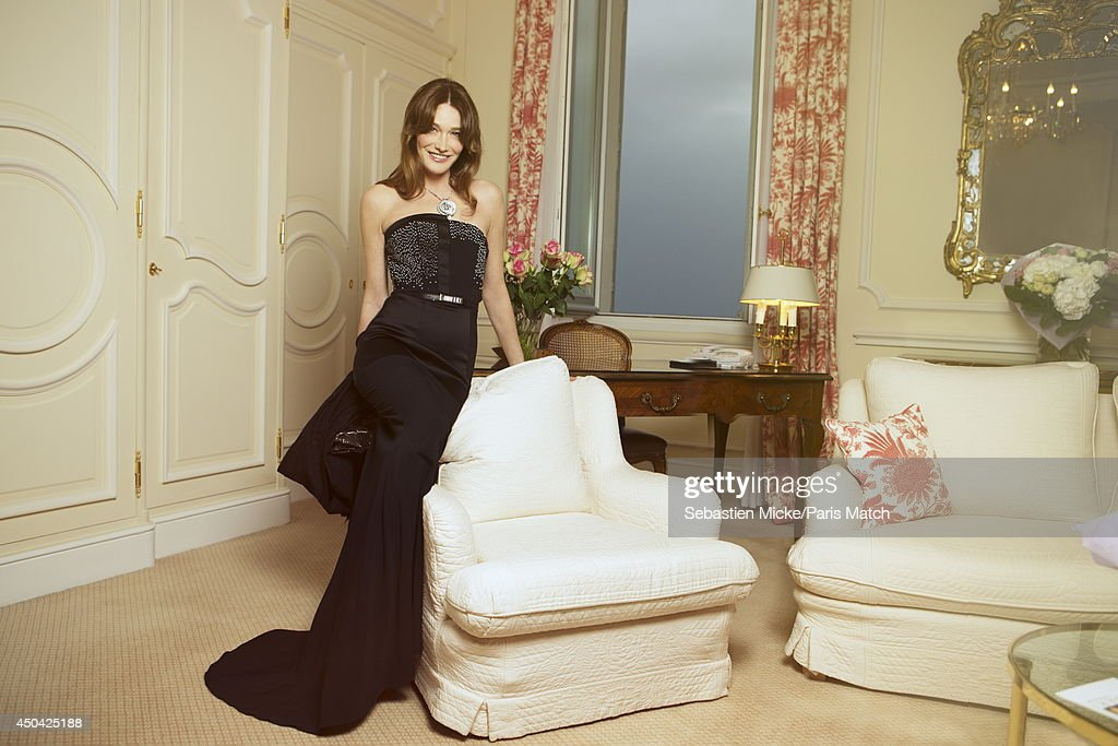 at the 21th Gala of AmFar Cinema Aganist AIDS, Carla Bruni Sarkozy wearing a Maxime Simoens dress with a Bulgari jewelry is photographed for Paris Match in Cap d'Antibes at the Hotel Cap-Eden-Roc on May 22, 2014;
