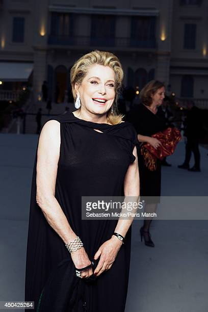 at the 21th Gala of AmFar Cinema Aganist AIDS Catherine Deneuve wearing a Vionnet dress with a Boucheron jewelry is photographed for Paris Match in...
