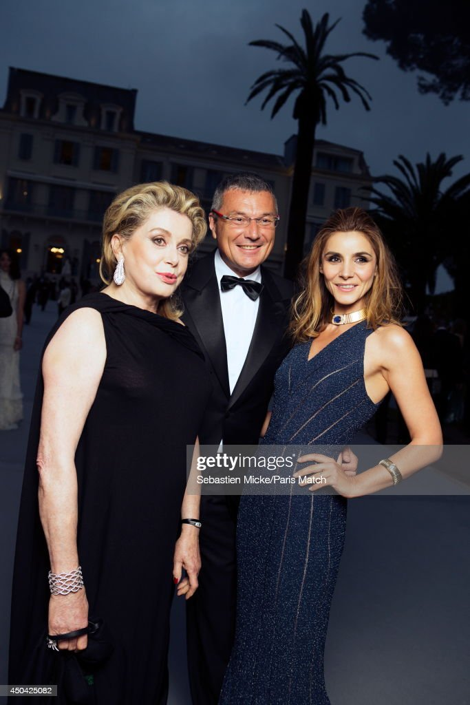at the 21th Gala of AmFar Cinema Aganist AIDS, Catherine Deneuve, Jean-Christophe Babin and Clotilde Courau are photographed for Paris Match in Cap d'Antibes at the Hotel Cap-Eden-Roc on May 22, 2014;