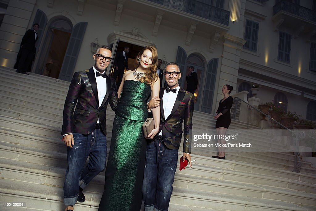 at the 21th Gala of AmFar Cinema Aganist AIDS, Dean and Dan Caten with Enriko Mihalik wearing a Dsquared dress are photographed for Paris Match in Cap d'Antibes at the Hotel Cap-Eden-Roc on May 22, 2014;