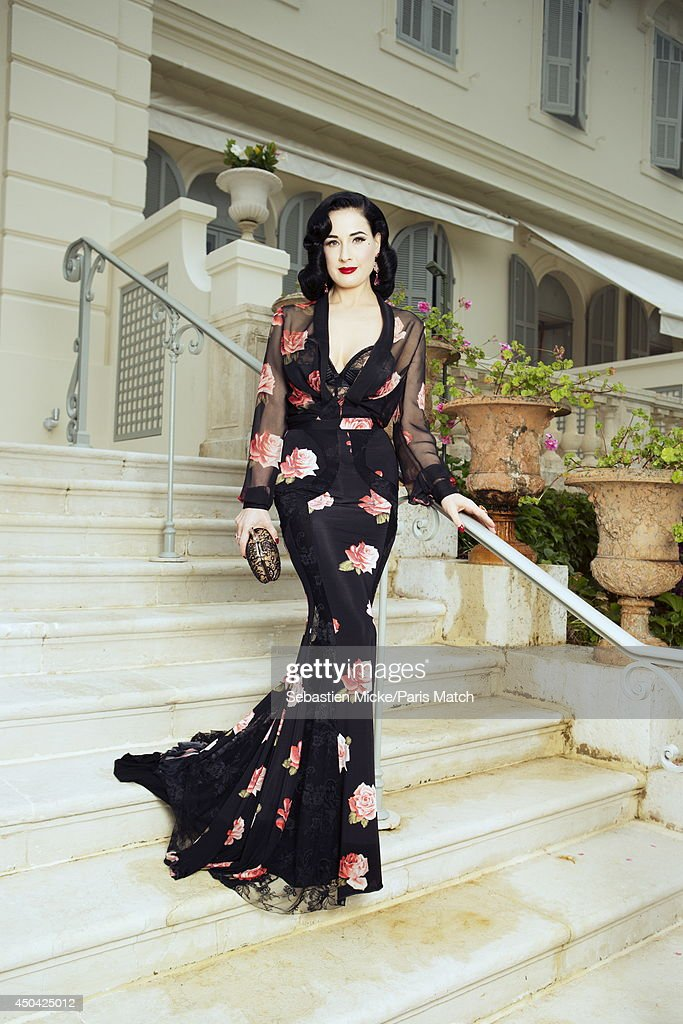 at the 21th Gala of AmFar Cinema Aganist AIDS, Dita Von Teese wearing a Blumarine with a Chopard jewelry dress is photographed for Paris Match in Cap d'Antibes at the Hotel Cap-Eden-Roc on May 22, 2014;