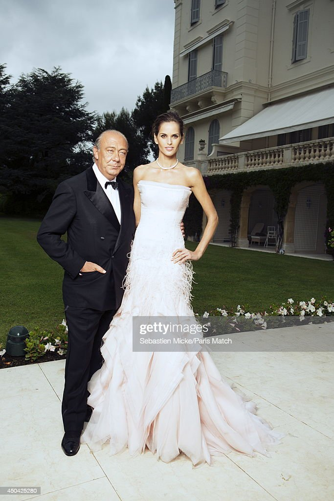 at the 21th Gala of AmFar Cinema Aganist AIDS, <a gi-track='captionPersonalityLinkClicked' href=/galleries/search?phrase=Fawaz+Gruosi&family=editorial&specificpeople=206588 ng-click='$event.stopPropagation()'>Fawaz Gruosi</a> and the brazilian model <a gi-track='captionPersonalityLinkClicked' href=/galleries/search?phrase=Izabel+Goulart&family=editorial&specificpeople=566749 ng-click='$event.stopPropagation()'>Izabel Goulart</a> wearing a Emilio Pucci dress are photographed for Paris Match in Cap d'Antibes at the Hotel Cap-Eden-Roc on May 22, 2014;