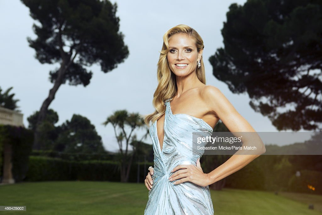 at the 21th Gala of AmFar Cinema Aganist AIDS, Heidi Klum wearing a Versace dress is photographed for Paris Match in Cap d'Antibes at the Hotel Cap-Eden-Roc on May 22, 2014;