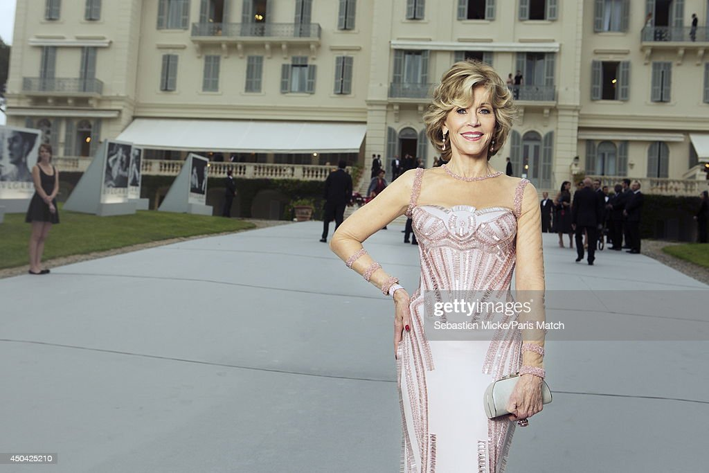 at the 21th Gala of AmFar Cinema Aganist AIDS, <a gi-track='captionPersonalityLinkClicked' href=/galleries/search?phrase=Jane+Fonda&family=editorial&specificpeople=202174 ng-click='$event.stopPropagation()'>Jane Fonda</a> wearing a Versace dress with Chopard jewelry is photographed for Paris Match in Cap d'Antibes at the Hotel Cap-Eden-Roc on May 22, 2014;