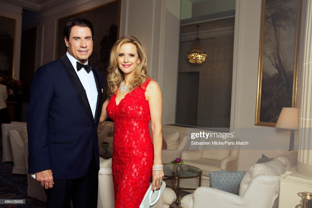 at the 21th Gala of AmFar Cinema Aganist AIDS, John Travolta with his wife Kelly Preston wearing a Olier Tolentino Couture dress are photographed for Paris Match in Cap d'Antibes at the Hotel Cap-Eden-Roc on May 22, 2014;