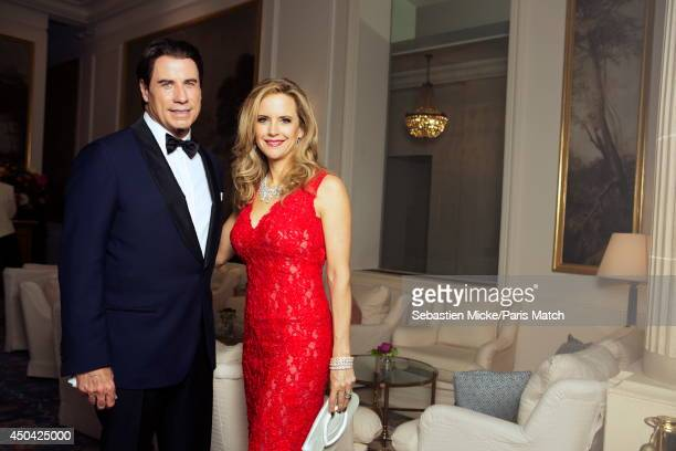 at the 21th Gala of AmFar Cinema Aganist AIDS John Travolta with his wife Kelly Preston wearing a Olier Tolentino Couture dress are photographed for...