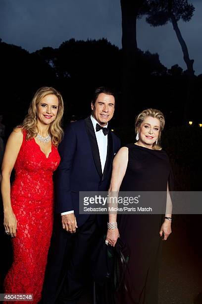 at the 21th Gala of AmFar Cinema Aganist AIDS John Travolta with his wife Kelly Preston wearing a Olivier Tolentino Couture dress and Catherine...
