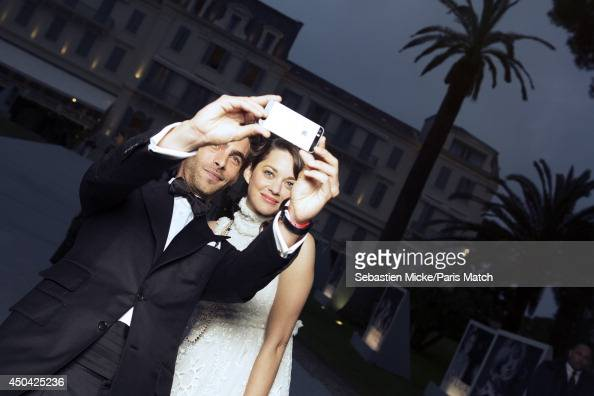 at the 21th Gala of AmFar Cinema Aganist AIDS Marion Cotillard a Alexander McQueen dress and the spanish model Jon Kortajarena are photographed for...