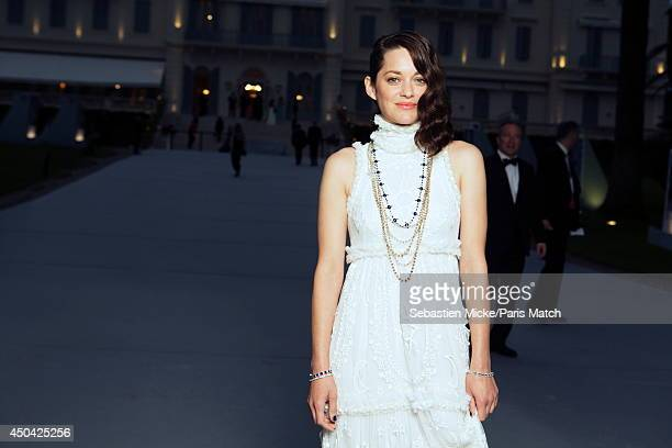 at the 21th Gala of AmFar Cinema Aganist AIDS Marion Cotillard wearing a Alexander McQueen dress is photographed for Paris Match in Cap d'Antibes at...