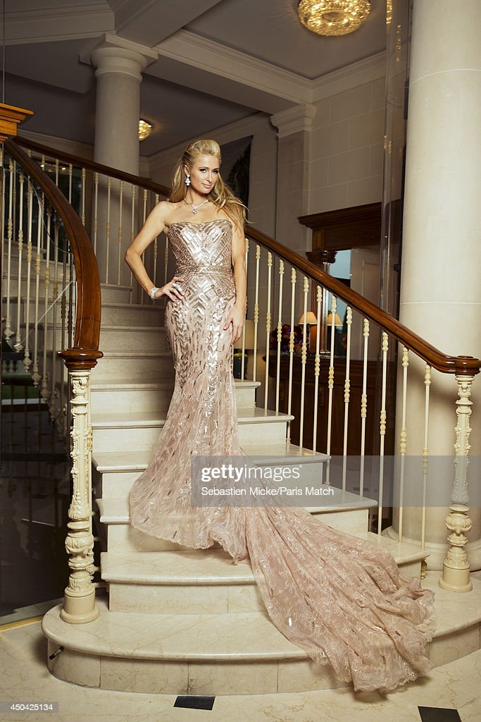 at the 21th Gala of AmFar Cinema Aganist AIDS, Paris Hilton wearing a Versace dress is photographed for Paris Match in Cap d'Antibes at the Hotel Cap-Eden-Roc on May 22, 2014;