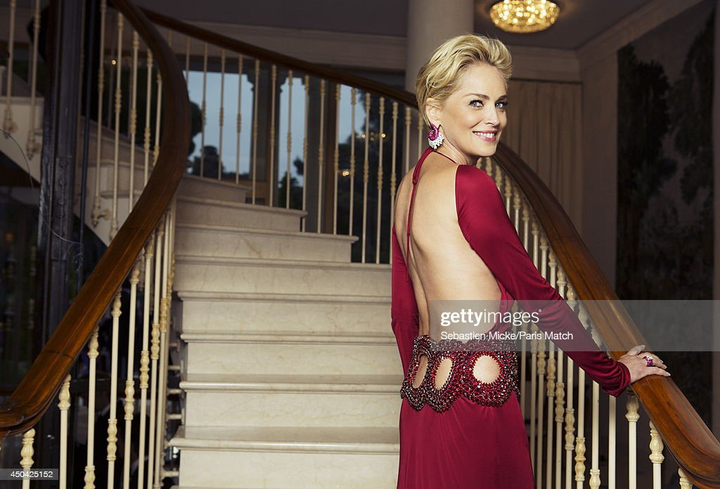 at the 21th Gala of AmFar Cinema Aganist AIDS, Sharon Stone wearing a Roberto Cavalli dress is photographed for Paris Match in Cap d'Antibes at the Hotel Cap-Eden-Roc on May 22, 2014;