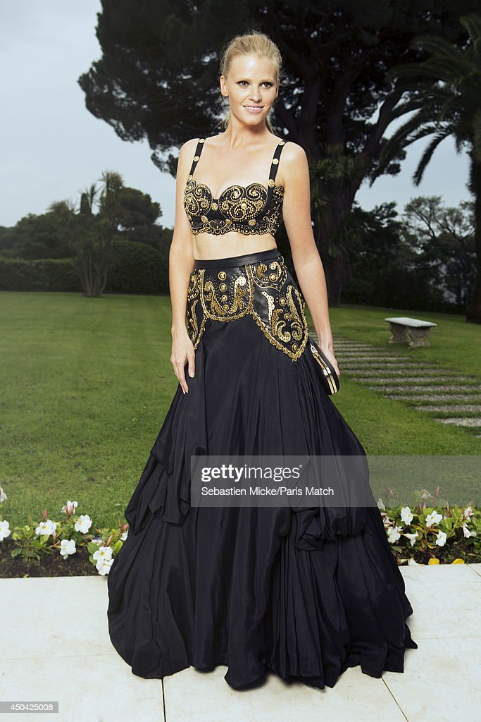 at the 21th Gala of AmFar Cinema Aganist AIDS, the model Lara Stone wearing a Versace dress is photographed for Paris Match in Cap d'Antibes at the Hotel Cap-Eden-Roc on May 22, 2014;