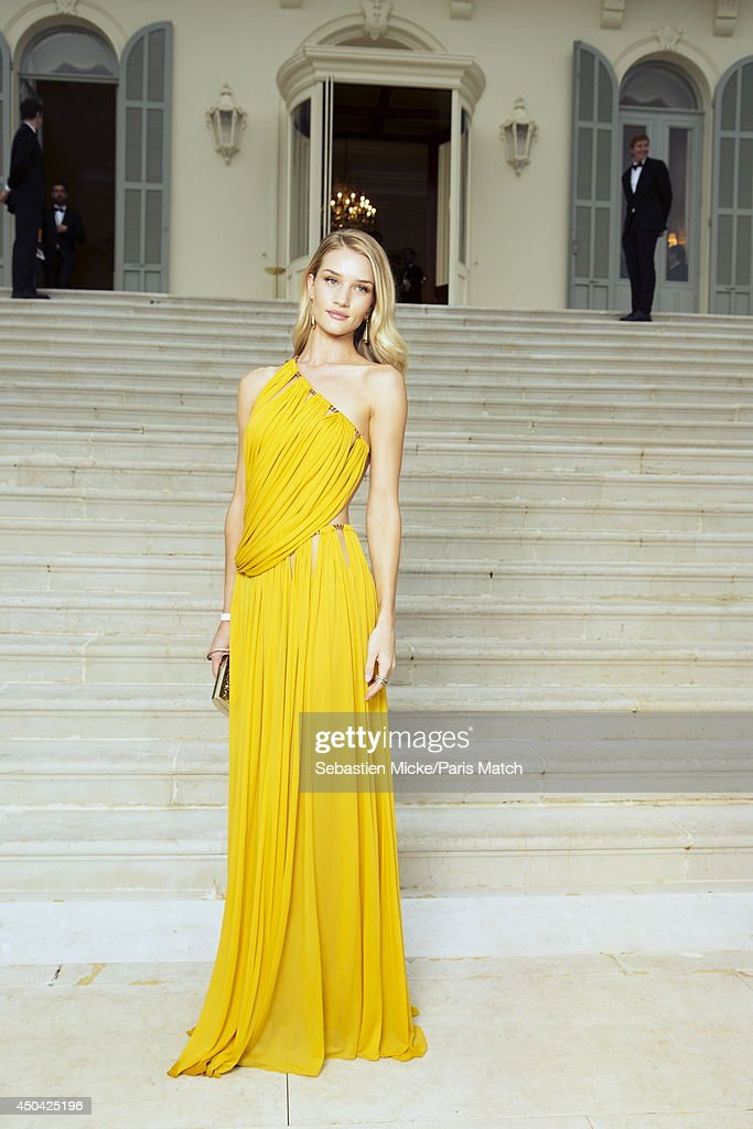at the 21th Gala of AmFar Cinema Aganist AIDS, the model <a gi-track='captionPersonalityLinkClicked' href=/galleries/search?phrase=Rosie+Huntington-Whiteley&family=editorial&specificpeople=2244343 ng-click='$event.stopPropagation()'>Rosie Huntington-Whiteley</a> wearing a Emilio Pucci dress with Bulgari jewelry is photographed for Paris Match in Cap d'Antibes at the Hotel Cap-Eden-Roc on May 22, 2014;