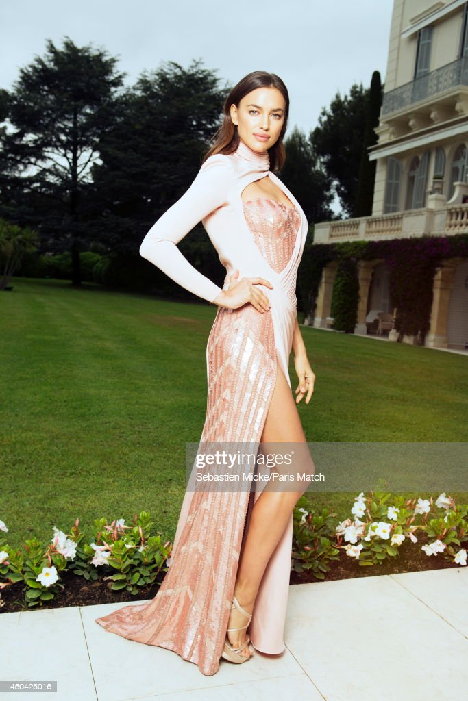 at the 21th Gala of AmFar Cinema Aganist AIDS, the russian model Irina Shayk wearing a Versace dress is photographed for Paris Match in Cap d'Antibes at the Hotel Cap-Eden-Roc on May 22, 2014;
