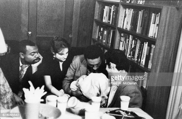 At the 8th St Bookshop American poet Ray Bremser shows off his infant daughter Rachel New York New York September 17 1960 Pictured admiring her are...