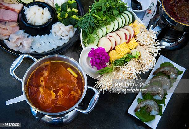 At the all you can eat Riverside Hotpot Cuisine some of the soup bases include Tomato and Brisket Broth left and Chongqing Spicy Broth September 22...