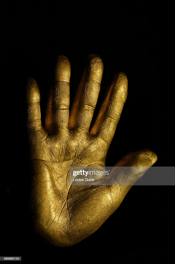 At the auction of Nelson Mandela's artwork from Robben Island his former prison a solid fine gold casting of Mandela's right hand was auctioned A...