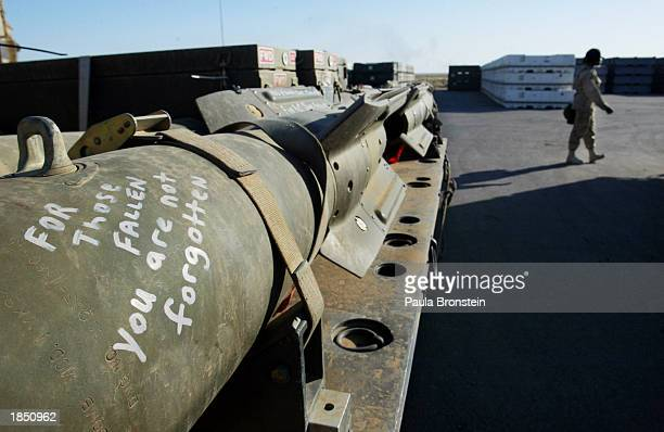 At the bomb dump at an air base in the Arabian Gulf messages are written by military personnel on Mark 82 a 500 pound bombs as they sit ready for use...