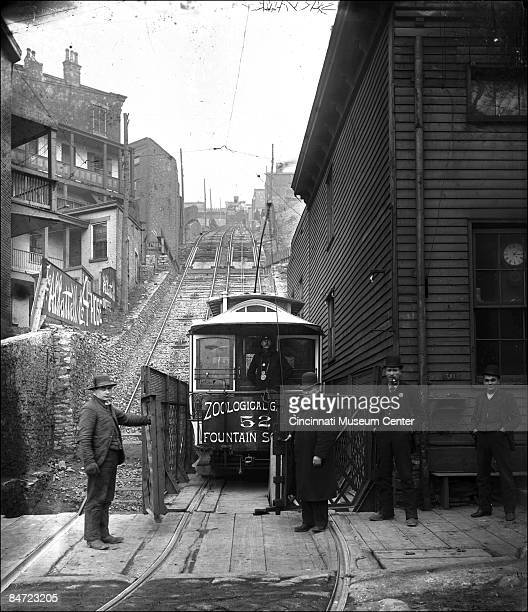 At the bottom of the hill men stand by the rail car that rides up the Mt Adams incline Cincinnati 1903
