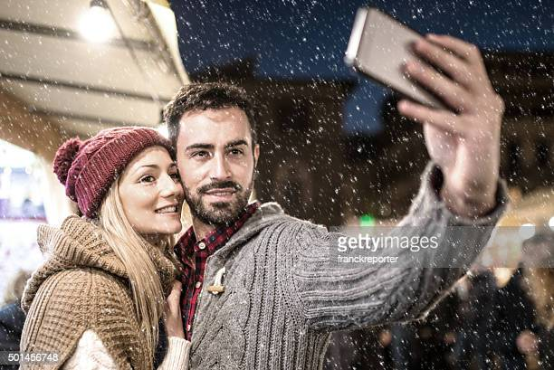 at the christmas market take a selfie under the snow