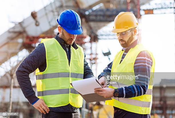 At the construction site, engineers discuss results