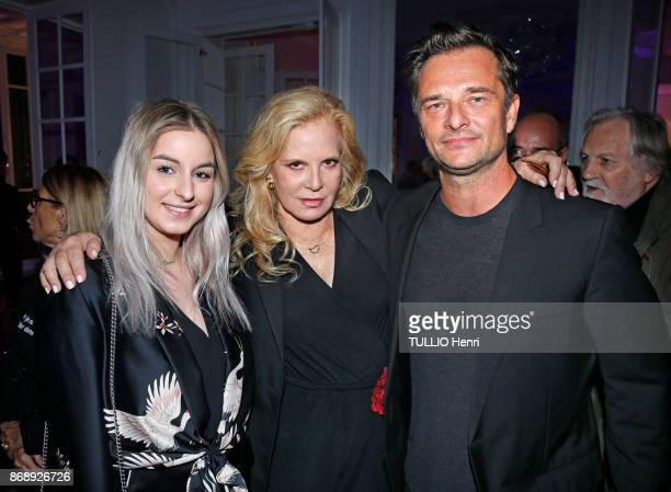 at the diner for the 14th concert of Sylvie Vartan at L'Olympia Sylvie Vartan with her childrens Darina Scotti and David Hallyday are photographed by...