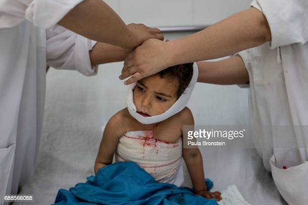 At the Emergency hospital in Lashkah Gar Najiba gets treated treated for injuries to her skull and chest caused by a rocket that landed next to her...