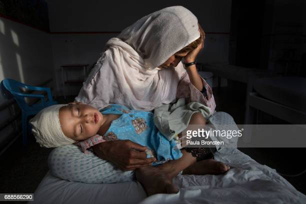 At the Emergency hospital Najiba holds her nephew Shabir age 2 who was injured from a bomb blast which killed his sister in Kabul on March 29 2016...