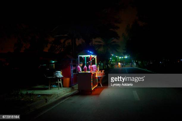 At the end of a long day a cotton candy vendor awaits customers in Zawra Park home to an amusement park and the city zoo The park shuts at 11 pm an...