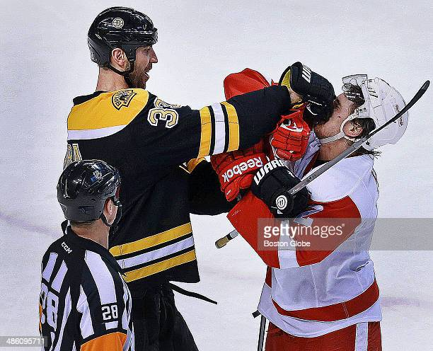 At the end of the first period Detroit's Brendan Smith got a smile out of Bruins captain Zdeno Chara as he challenged the big defenseman near the...