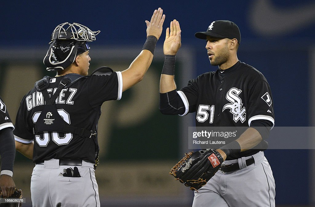 At the end of the game, Chicago White Sox catcher Hector Gimenez (38) and former Jay, Chicago White Sox right fielder Alex Rios (51) give each other a high five. The Toronto Blue Jays Tuesday night lost to the Chicago White Sox 4-3 at the Rogers Centre. The night saw the season debut of Brett Lawrie at 3rd base.