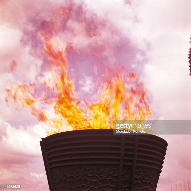At the end of the opening ceremony the Olympic fire is burning in the cauldron at the top of the National Olympic Stadium of Tokyo Tokyo October 10...