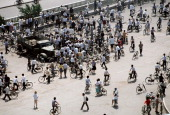 At the end of the prodemocracy movement in China onlookers view Chinese Army trucks and vehicles that were damaged or destroyed during the night of...