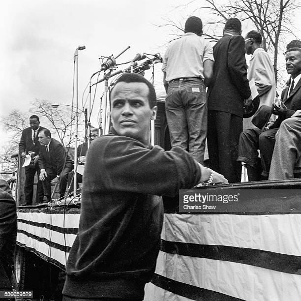 At the end of the Selma to Montgomery March American singer and activist Harry Belafonte leans on a podium in front of the Alabama State Capitol...