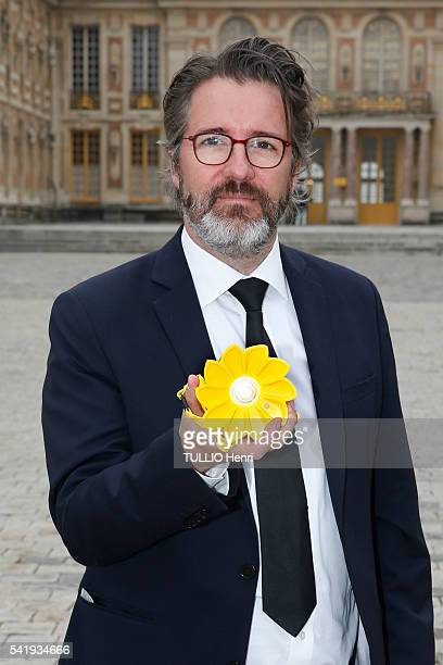 at the evening gala at the Chateau de Versailles for the opening of the exhibition Olafur Eliassion the artist wears a little sun light producer art...