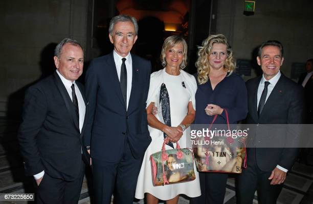 at the evening gala for the new collection Masters of louis Vuitton by Jeff Koons Michael Burke Bernard Arnault with his wife Helene and Jeff Koons...