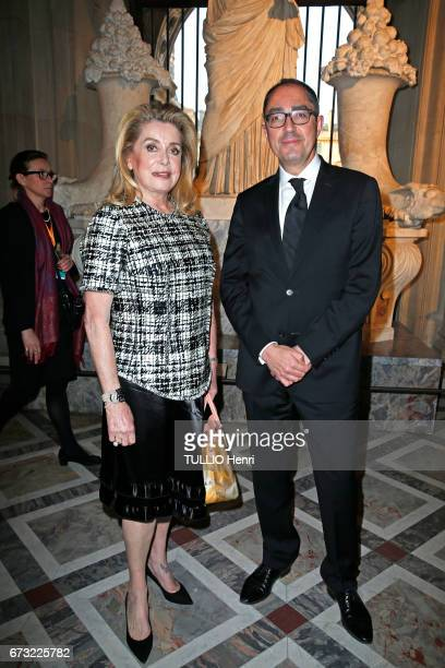 at the evening gala for the new collection Masters of louis Vuitton by Jeff Koons Catherine Deneuve and JeanLuc Martinez pose for Paris Match on...