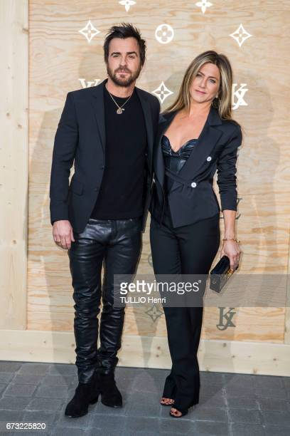 at the evening gala for the new collection Masters of louis Vuitton by Jeff Koons Justin Theroux with his wife Jennifer Aniston pose for Paris Match...