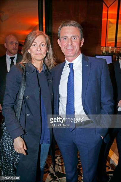 at the evening gala for the new restaurant Noto Anne Gravoin and her husband Manuel Valls pose for Paris Match on march 29 2017 in Paris France