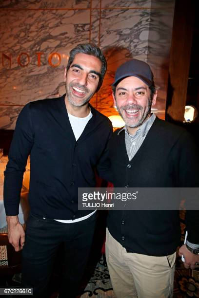 at the evening gala for the new restaurant Noto Ary Abittan and manu Payet pose for Paris Match on march 29 2017 in Paris France