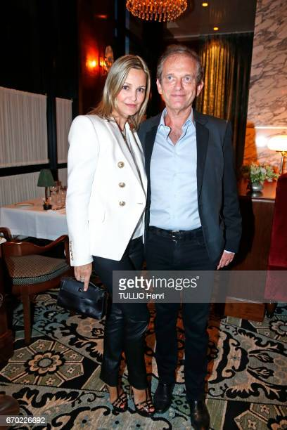 at the evening gala for the new restaurant Noto Frederic Saldmann and his wife Marie pose for Paris Match on march 29 2017 in Paris France