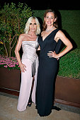 at the evening gala of AMFAR charity event to benefit the fight against AIDS at the hotel Peninsula Jennifer Garner and Donatella Versace pose for...