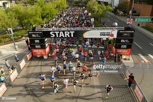 At the firing of the race gun runners sprint from the starting line to begin the 35th annual Cherry Creek Sneak 10 mile race on April 23 2017 in...