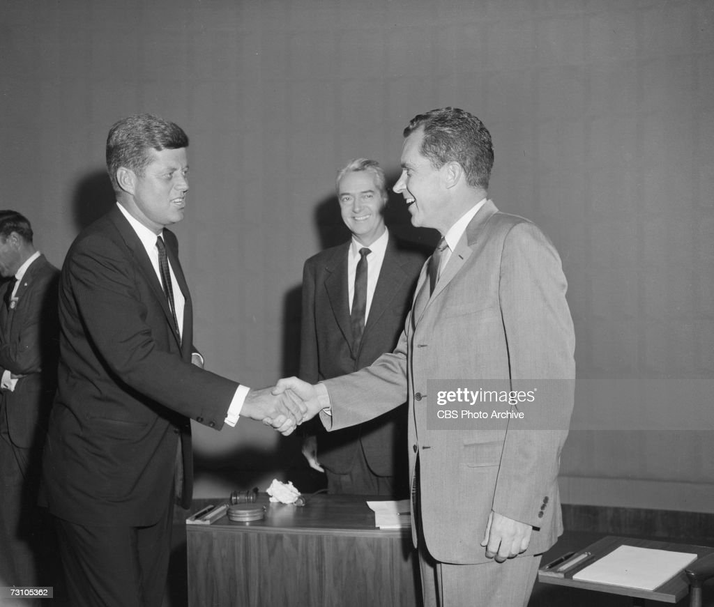 At the first televisied presidential debate, American then-senator and future President <a gi-track='captionPersonalityLinkClicked' href=/galleries/search?phrase=John+F.+Kennedy+-+US+President&family=editorial&specificpeople=70027 ng-click='$event.stopPropagation()'>John F. Kennedy</a> (1917 - 1963) (left) and then-Vice President and future President Richard Nixon (1913 - 1994) shake hands as journalist and debate chairman Howard K. Smith (1914 - 2002) smiles behind them, Chicago, Illinois, September 25, 1960.