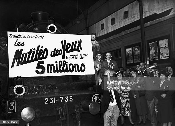 'At The Gare SaintLazare The Jackpot Is Paid The National Lottery Board Train Radio On August 17Th 1939