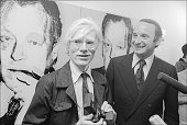 At the German consulate American Pop Andy Warhol poses with his painting of former German Chancellor Willy Brandt New York New York June 25 1976