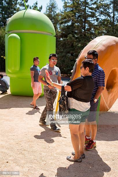 At the Googleplex headquarters of the search engine company Google in the Silicon Valley town of Mountain View California tourists take a selfie in...