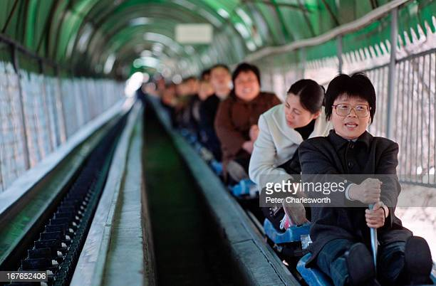 At the Great Wall at Badaling tourists can save their legs by taking the Disneylike sled ride up and down the mountain to reach the Wall itself