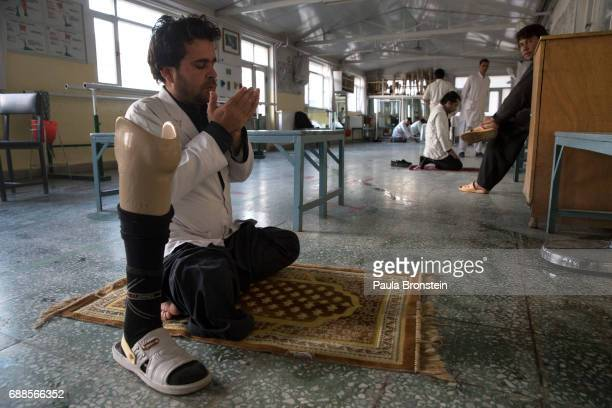 At the ICRC Orthopedic center a handicapped employee prays after finishing his duties Every year the UN comes out with their report documenting the...